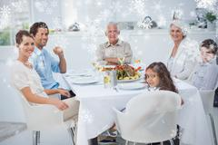 Composite image of family smiling at the dinner table - stock illustration