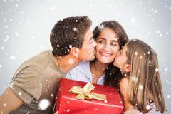 Stock Illustration of Composite image of father and his daughter offering a red gift