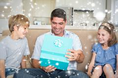 Composite image of father opening gift given by children on sofa - stock illustration