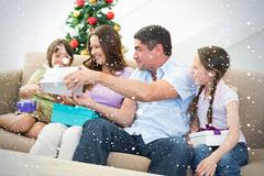Composite image of family exchanging christmas presents Stock Illustration