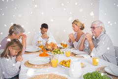Composite image of family saying grace before eating a turkey - stock illustration
