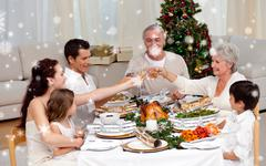 Composite image of family toasting in a christmas dinner - stock illustration