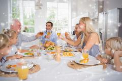 Composite image of adults raising their glasses at thanksgiving dinner - stock illustration