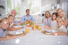 Composite image of family celebrating thanksgiving - stock illustration