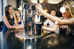 Composite image of blonde woman pulling a pint of stout Stock Illustration