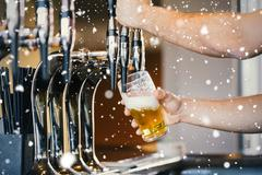 Composite image of barmans arms pulling a pint of beer Stock Illustration