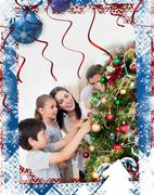 Composite image of happy family decorating a christmas tree with boubles Stock Illustration
