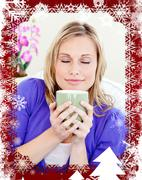 Stock Illustration of Blond woman enjoy her coffee sitting on the sofa