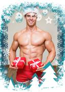 Composite image of shirtless macho man in santa hat holding gifts - stock illustration