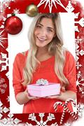 Composite image of blonde woman receiving a gift - stock illustration