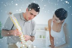 Chiropractor and patient looking at a model of a spine - stock illustration