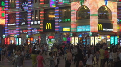 Commercial neon sign tourist people night Guangzhou city shopping crowd area fun Stock Footage
