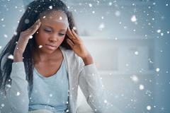 Composite image of woman experiencing a headache Stock Photos