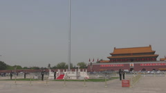 Armed soldier guard national Chinese flag Tiananmen Square Beijing day Asia icon Stock Footage