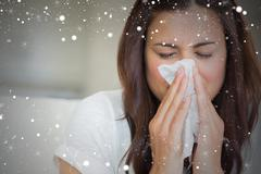 Composite image of brunette blowing nose into tissue Stock Illustration