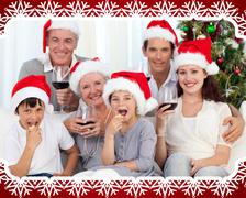 Family drinking wine and eating sweets in christmas Stock Illustration