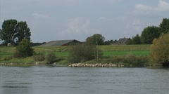 CORTENOEVER shed and farmhouse towering above dike + river IJssel Stock Footage