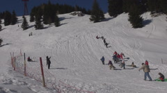 Happy children enjoy play sledge snow mountain hill winter holiday fun sunny day Stock Footage