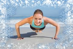 Stock Illustration of Composite image of fit woman in plank position on the beach