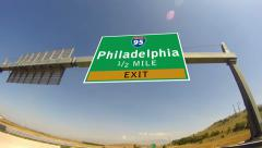 4k driving on highway/interstate,  exit sign of the city of philadelphia, pen Stock Footage