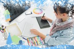 Artist drawing something on graphic tablet at office against snow Stock Illustration