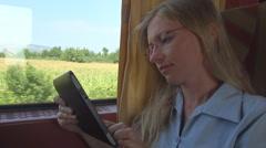 Happy business woman work digital tablet train enjoy reading travel summer day  Stock Footage