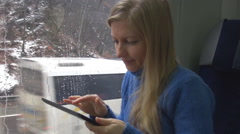 Beautiful young blonde woman work digital tablet train travel winter season day  Stock Footage