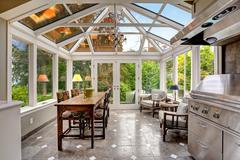 Sunroom patio area with transparent vaulted ceiling Stock Photos