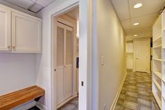 Basement interior. long corridor with tile floor Stock Photos