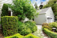 front yard green garden with walkway - stock photo