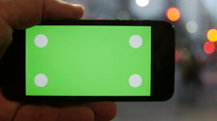 Cell Phone, touch screen, held by hands. Green screen Chroma Key. Close up. 4k Stock Footage