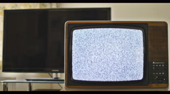 Outdated anologue TV next to LED TV 4K Stock Footage