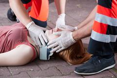 rescuers using cervical collar - stock photo