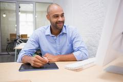 Man working at desk with computer and digitizer Stock Photos
