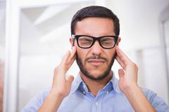 Close up of businessman with severe headache Stock Photos
