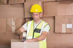 Worker preparing goods for dispatch - stock photo