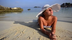 Portrait smiling girl with hat in bikini enjoying being alone by ocean on bea Stock Footage