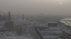 Aerial view Doha city skyline Spiral mosque traffic car street sand storm sunset Stock Footage