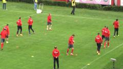 Players on training running for warm up before soccer or football match. Stock Footage