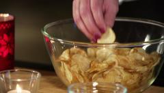 Woman taking crisps. - stock footage