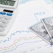 stock market graph with 100 dollars banknote and calculator - stock photo