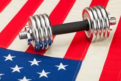 Stock Photo of dumbbells over us flag as symbol of healthy nation