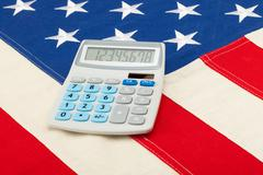 Stock Photo of neat calculator over usa flag