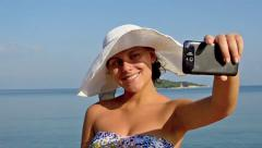 Taking selfie. beautiful model taking selfie pictures with smartphone at ocea Stock Footage