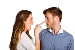 Casual young couple in an argument Stock Photos