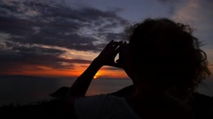 Woman Taking Picture of Sunset. Slow Motion. Stock Footage