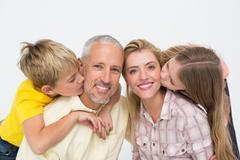 Stock Photo of Happy family smiling and showing affection