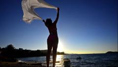 Silhouette of dancing woman sith scarf on the beach wind, inspiration,slow mo Stock Footage