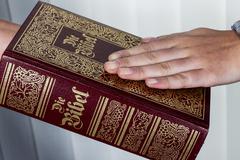 Witness swearing on bible Stock Photos