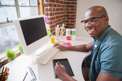 Casual designer using graphics tablet - stock photo